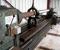 Restauration d'une grande roue à godets en chêne et en acier - Usinage de l'axe 6